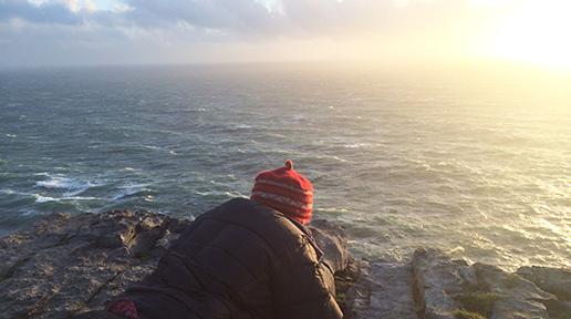 Sun setting beyond the cliffs. Photo: Sheila Langan